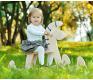 Ребенок на лошадке-качалке